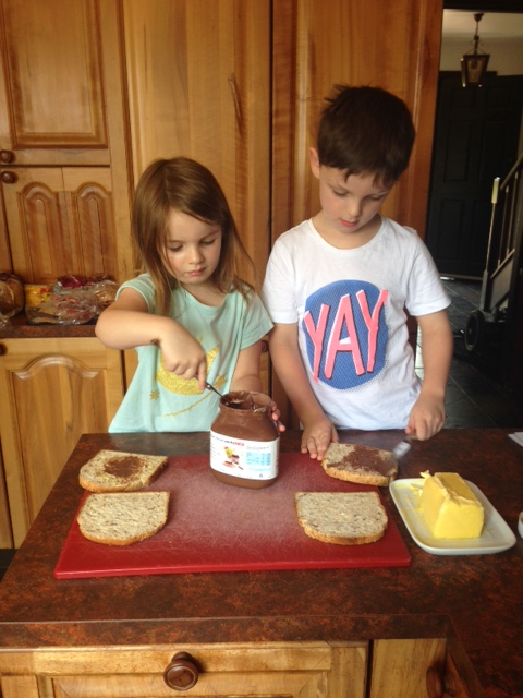 My kids making their own sandwiches. They thought this was fun and I liked not making them. Side Note: During holidays we have Nutella and unhealthy cereal, another fun treat.