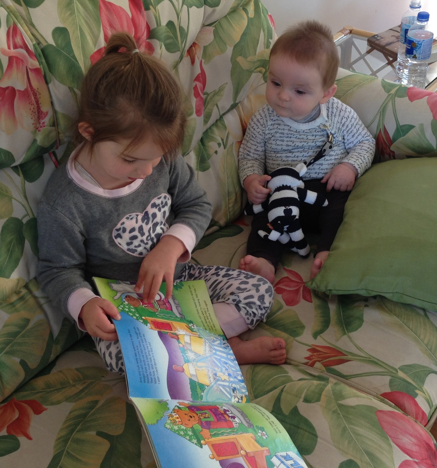 Franklin having a book read to him by big sister Eva on our holiday