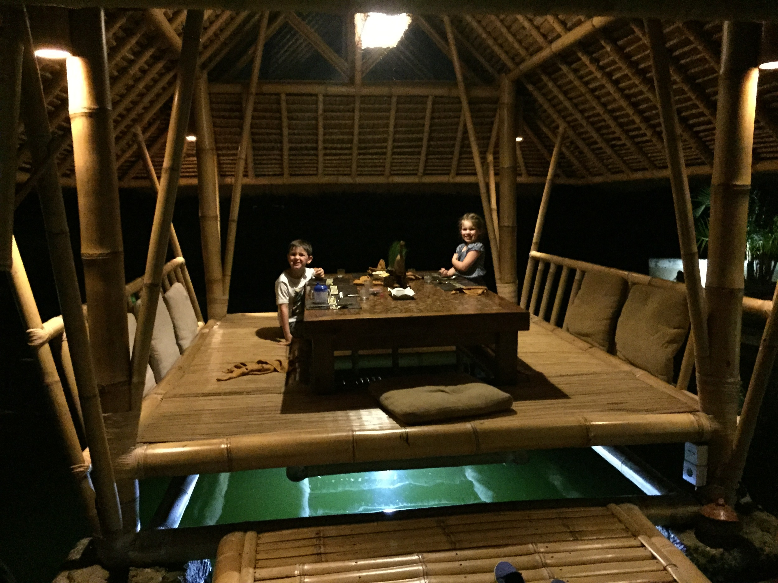 Dinner in a bamboo hut floating over a fish pond, Ubud