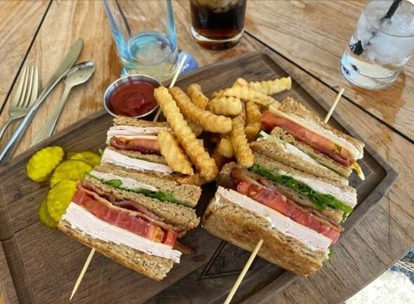 Martin's lunch - the American Club. Martin says he knows he's in the US when his mouth cramps trying to fit the sandwiches in.