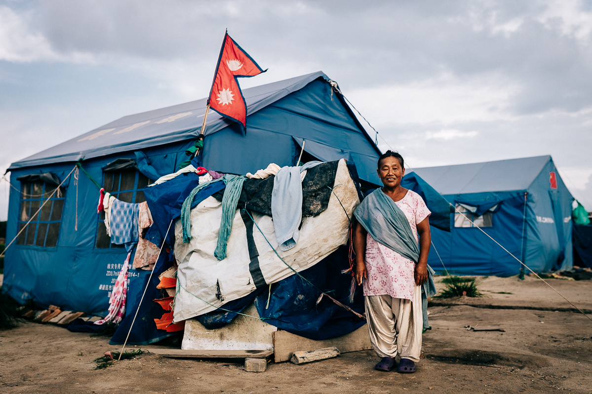 One of the many environmental refugee requested for a portrait of herself and the Nepal's national flag together.  Kathmandu, Nepal   2015