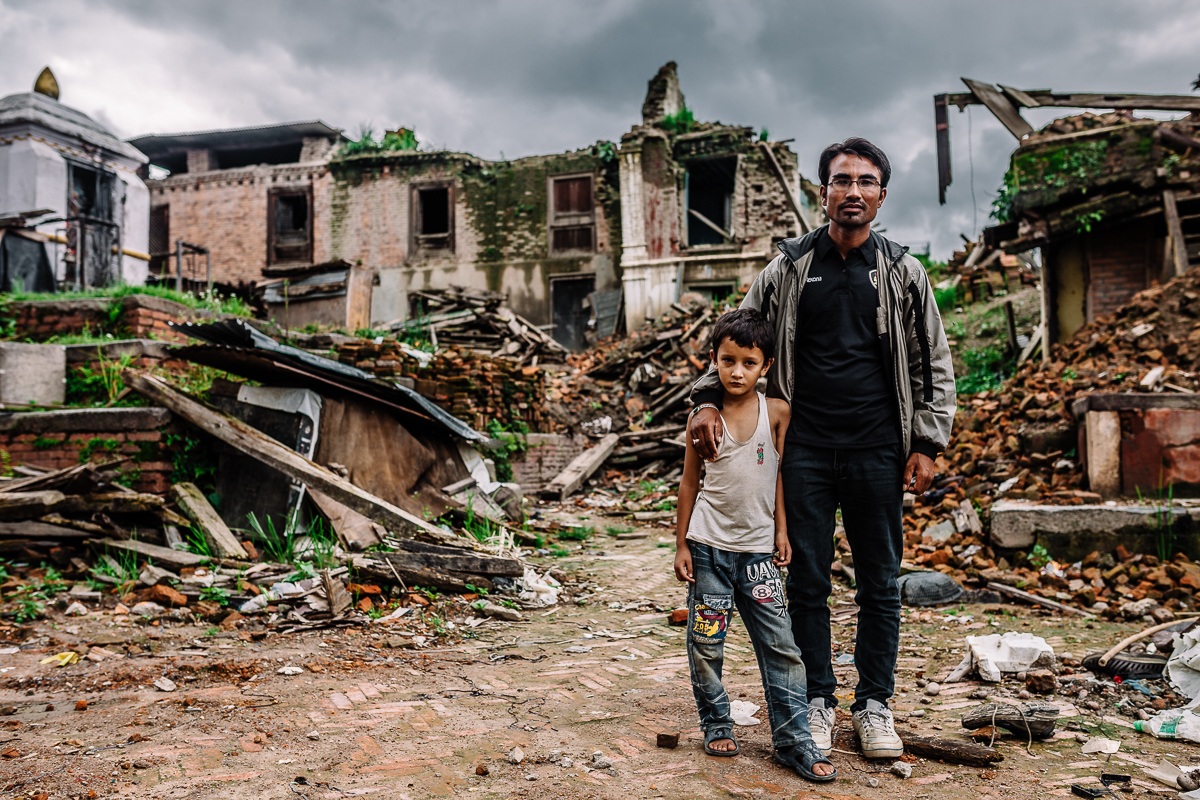 Shree Krishna had to dig for hours continuously to save his own son who was trapped under the rubbles. Reeling from his horrifying experience, he has decided to dedicate his time to social community work with the Red Cross as his way of being grateful for the second chance in life.  Photograph was taken infront of their old home.  Sankhu, Nepal   2015