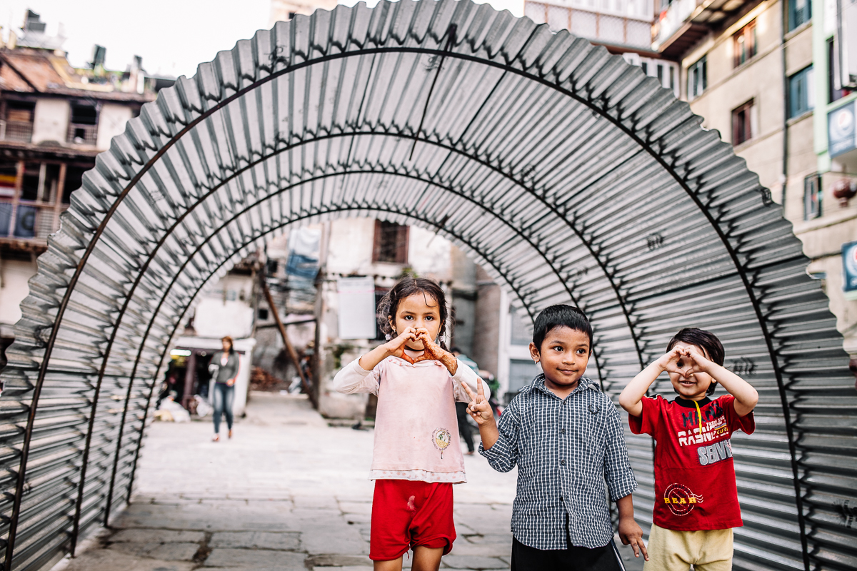 Children playing infront of a makeshift tent for those who have lost their homes.  Bakhtapur, Nepal   2015