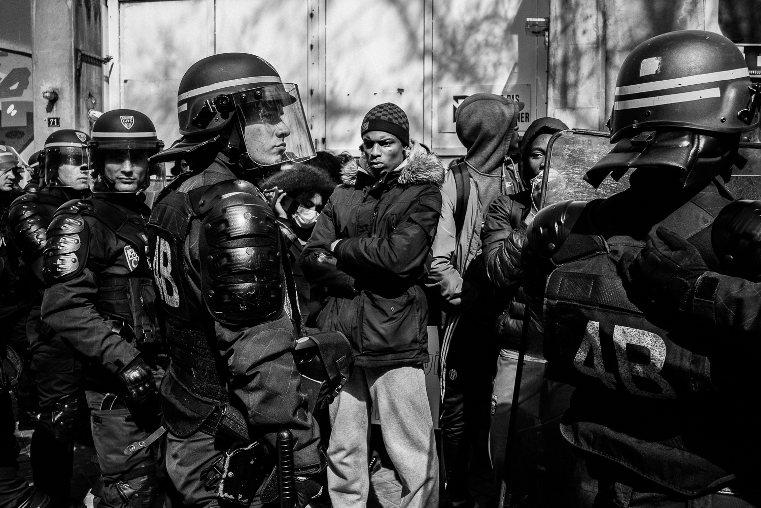 Riot police officers cordoning off a group of protestors, 5th April 2016.