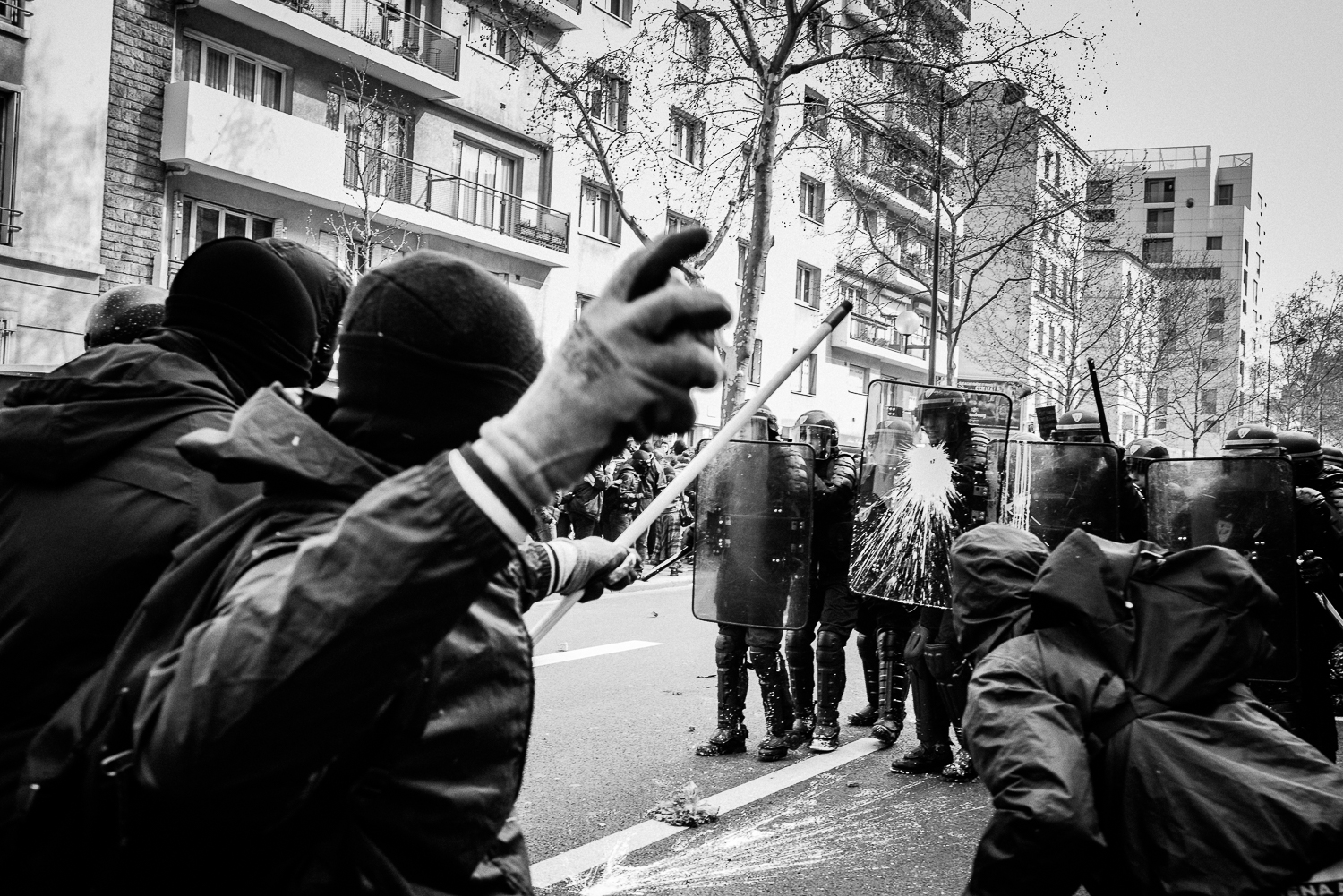 A young protestor throwing a stone towards the riot police,5th April 2016.
