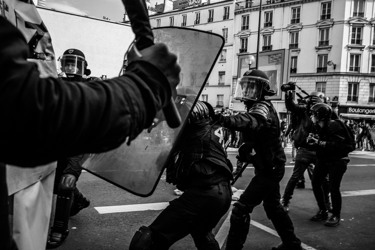 A riot police officer pulling his colleague out of the fray,5th April 2016.
