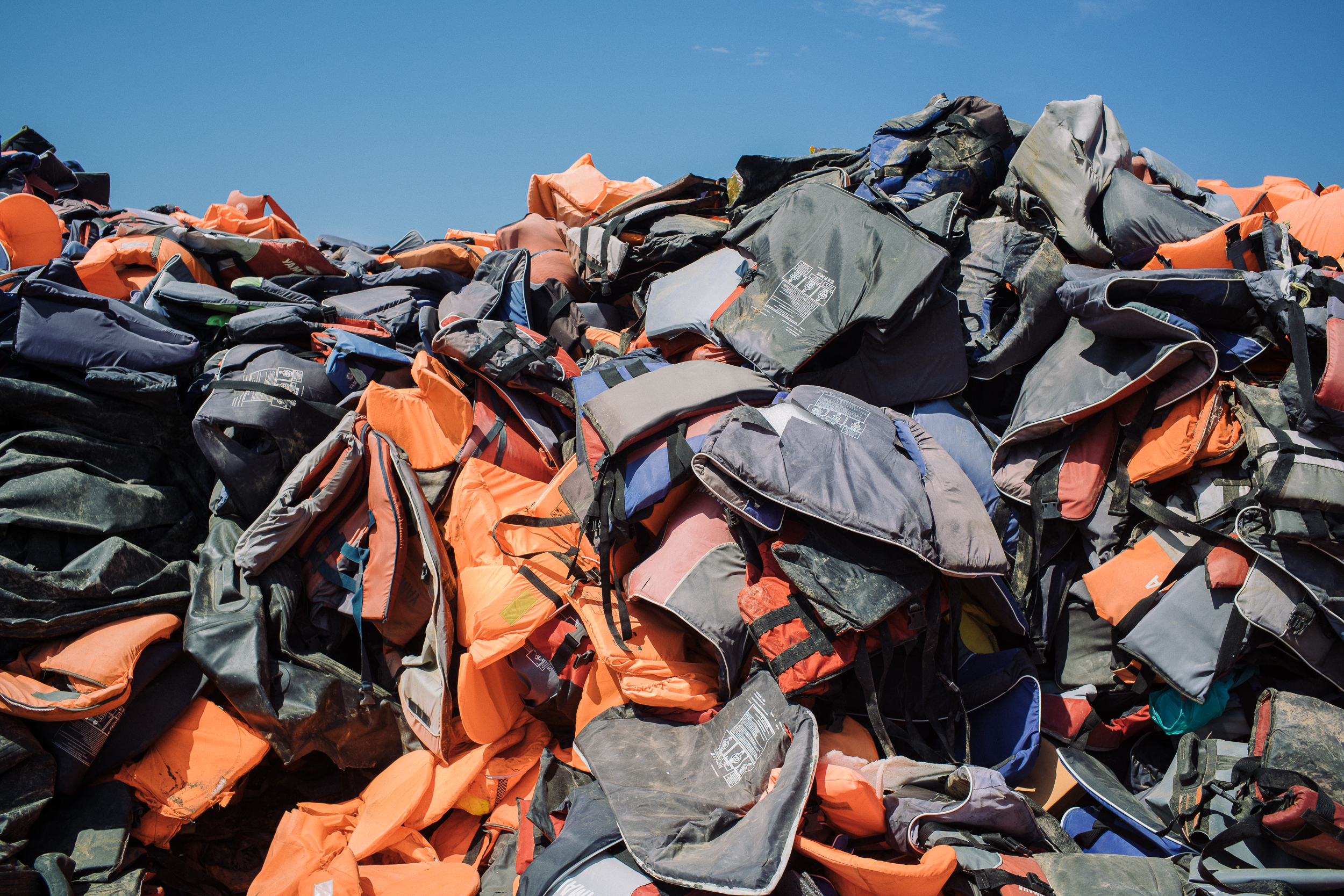 The Life Vest Cemetery where the hundreds of thousands of life vests were collected from the shores of Lesvos, reaching a height of 10m at a certain point, remains to be one of the most striking metaphors of the crisis