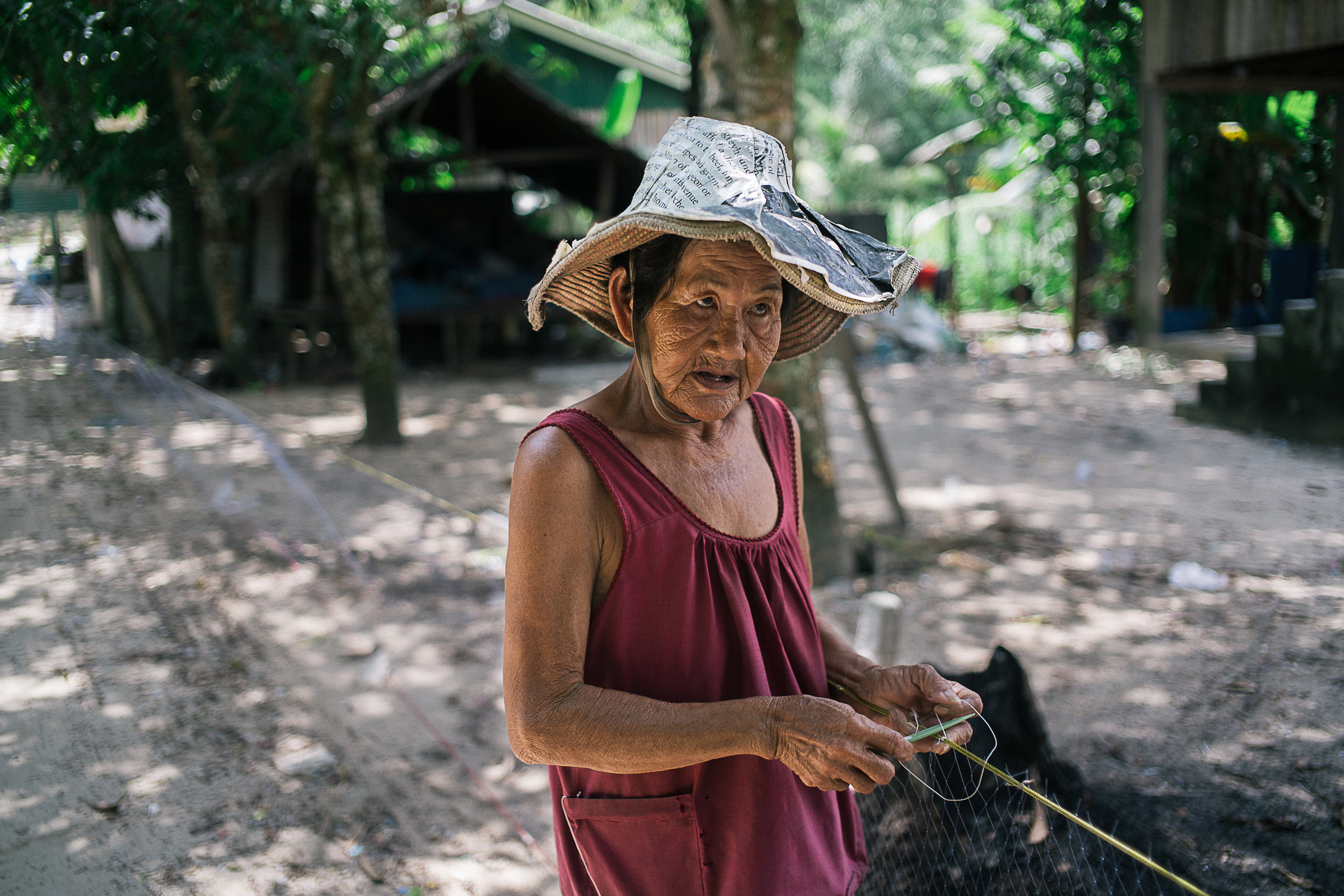 When Chao Sok Hom, 72, realised that her income was directly affected by the sand dredging ships, she joined many others to leave their home and work at the border cities across in Thailand.