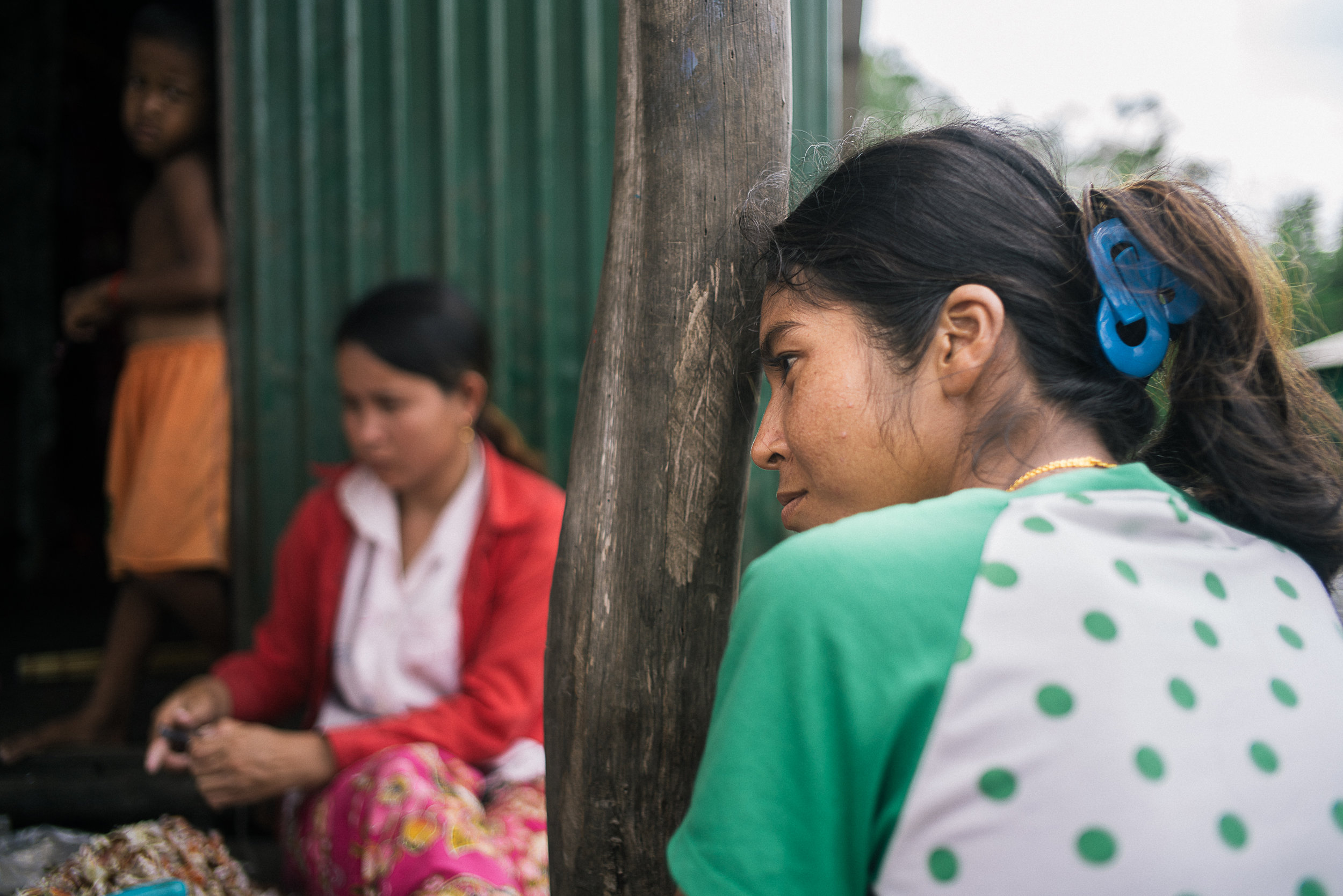 Chao Sok Teara, 26, have spent the past five years working on different plantations in Trad, Thailand. Coming back home is expensive due to the cost of legal paperwork each time she crosses back to Cambodia. The working conditions on these fields, she said, are harsh but earning money in her home village was much tougher.