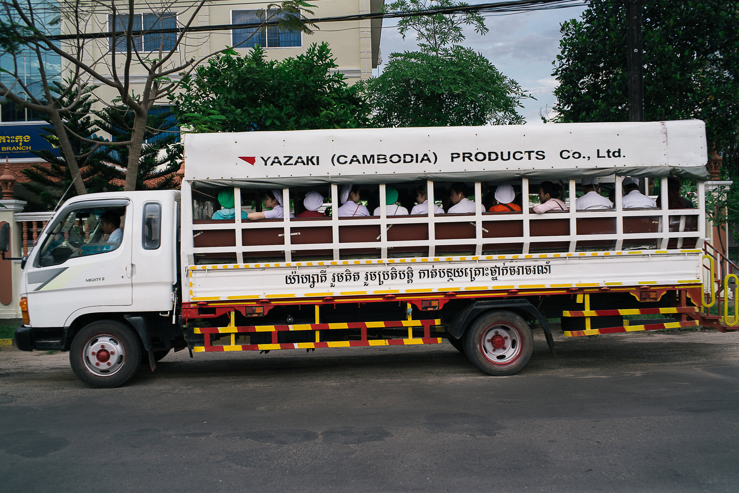 A truck full of SEZ workers returning home during the evening peak hour.