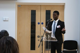 Ali Aden delivering his speech at the Character Symposium.