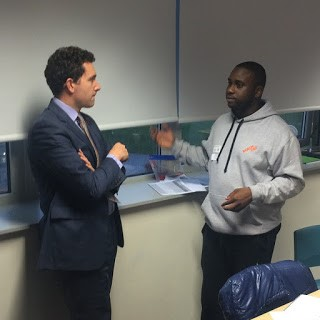 Edward Timpson talking to Sam Johnson, mentee turned mentor.