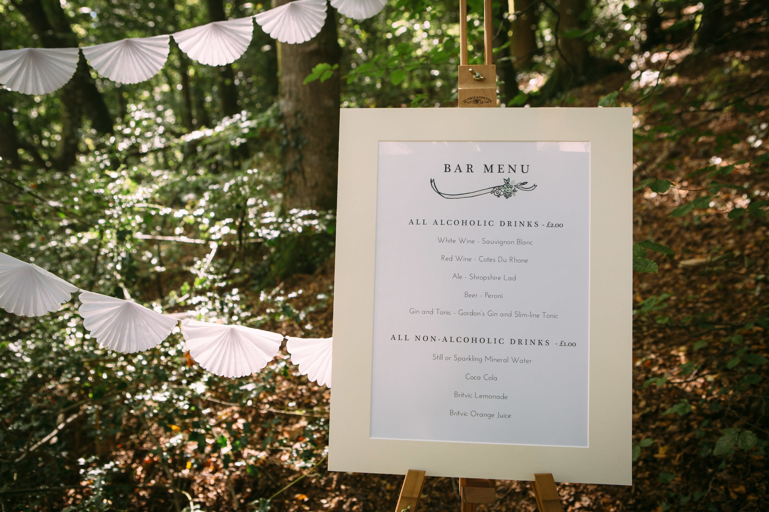Their  Classic 1950s bespoke collection  included everything from illustrated compact mirrors for favours to the menus, all featuring painted herb inspired foliage and clean classic typography.