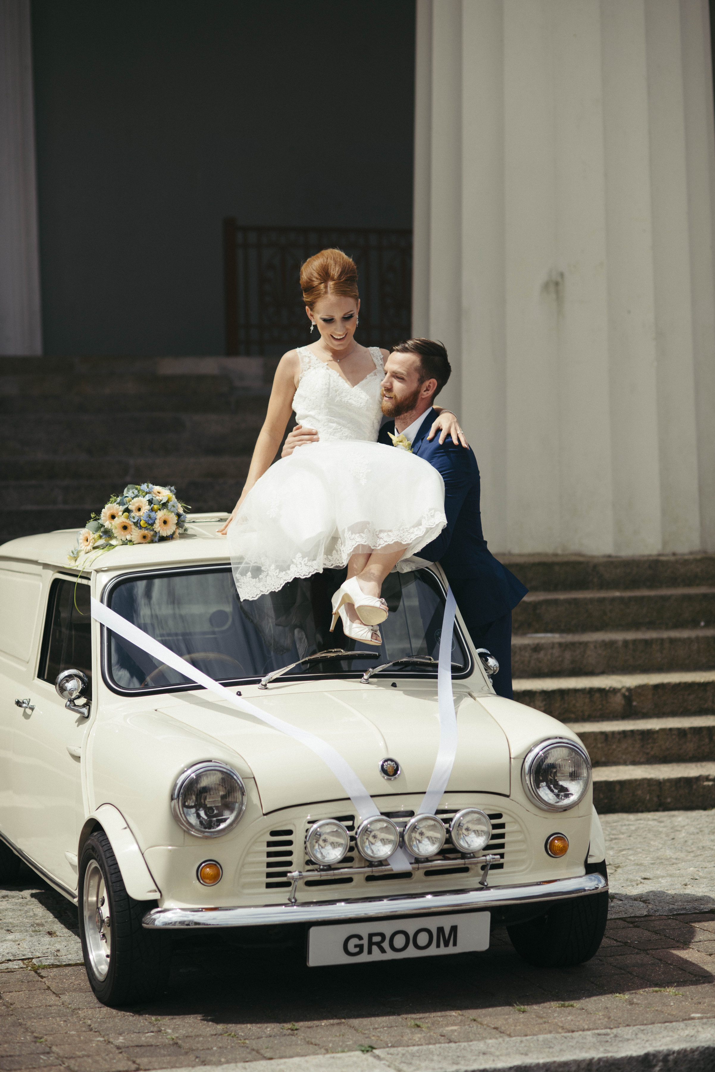 No 60s do would be complete without an original Mini, provided by  Groom2wedding  Photo by  Margo R
