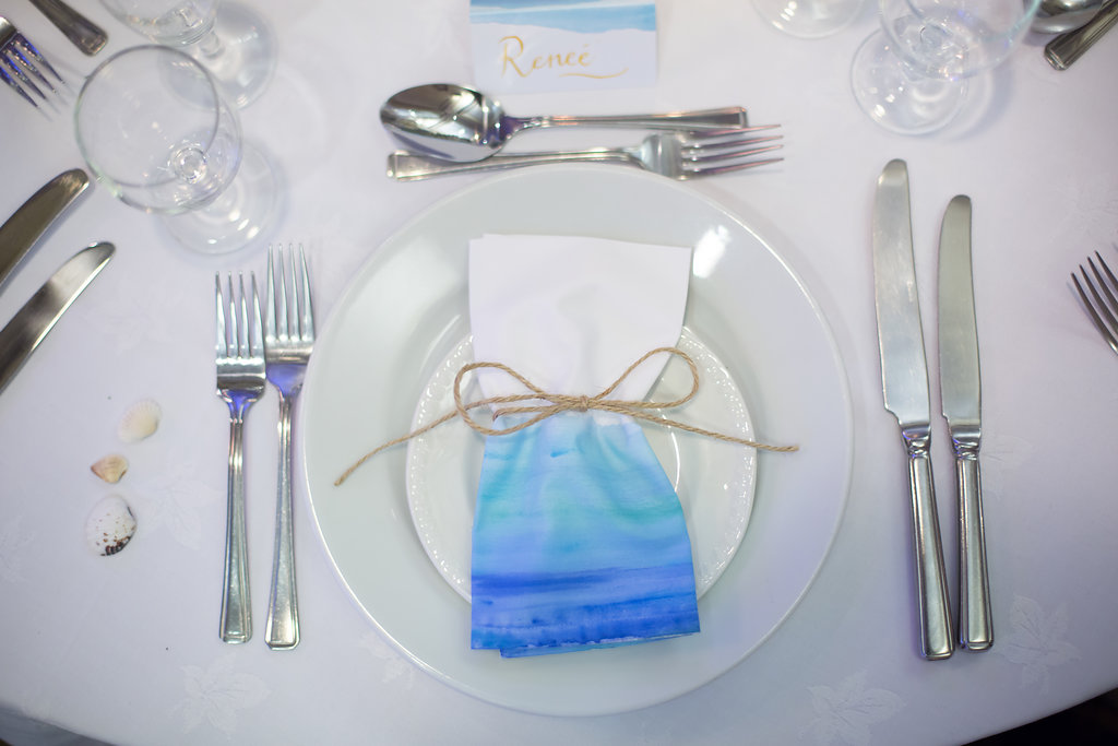 The hand painted napkins by the   The Wedding Hub  hand painted were created to coordinated with  our stationery design