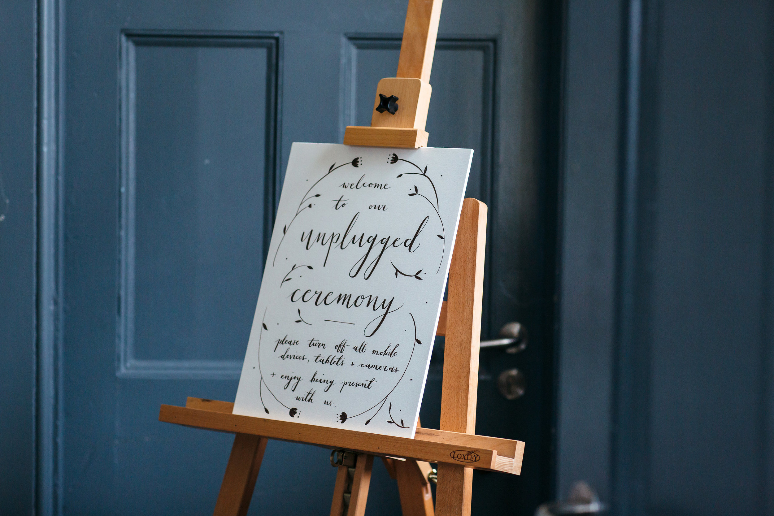 dearly beloved abi and ben unplugged ceremony hand painted sign