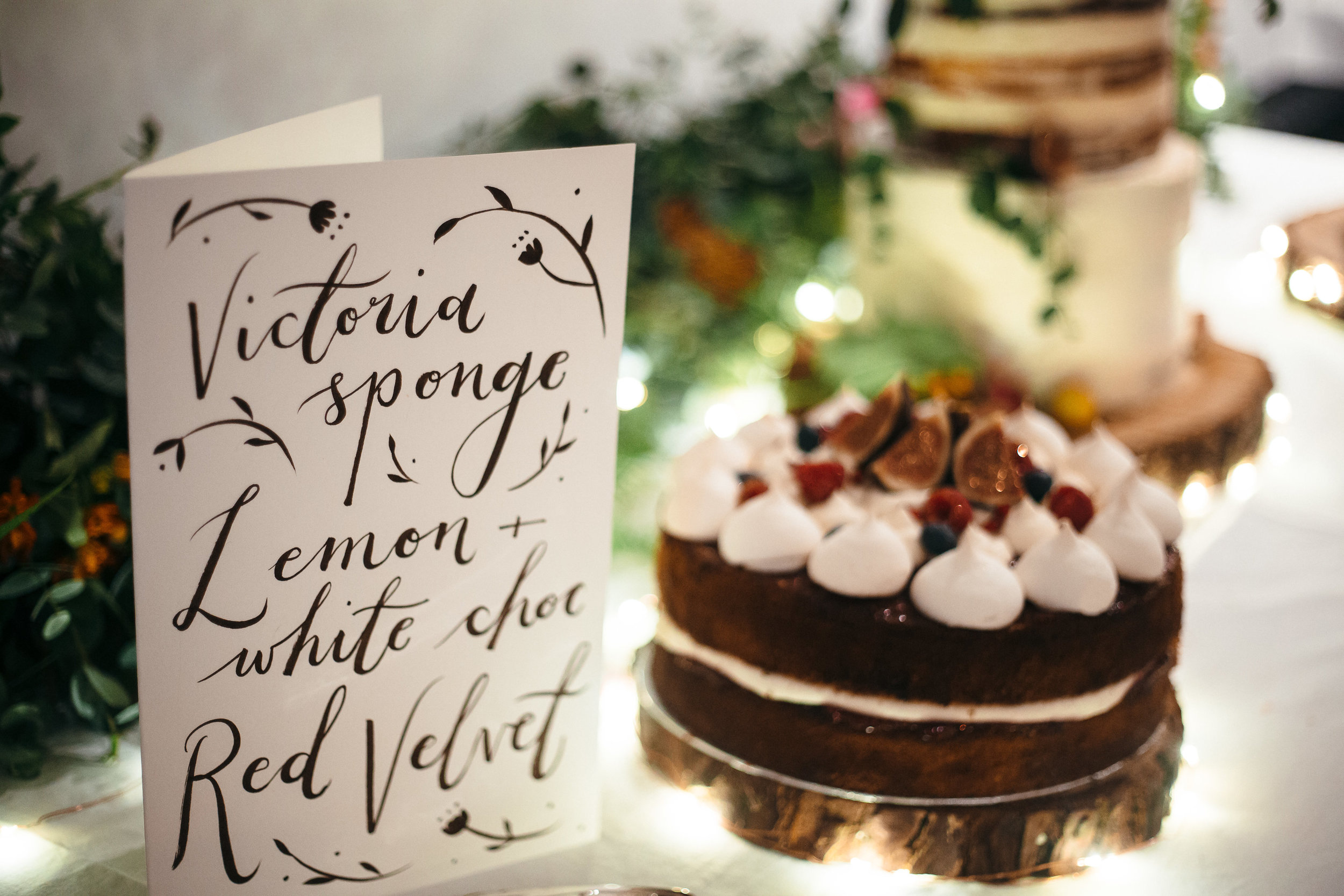 dearly beloved abi and ben wedding hand painted cake sign