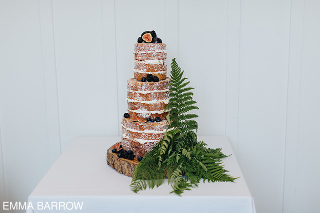 The magnificent naked cake was created by  Edible Essence  and decorated with natural ferns and figs and other fruit, the finishing touch was a couple of cute lego brides as cake toppers.
