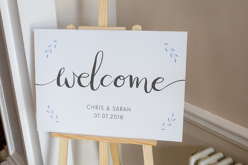 This large format welcome sign featuring hand painted lettering lead guests into the celebrations