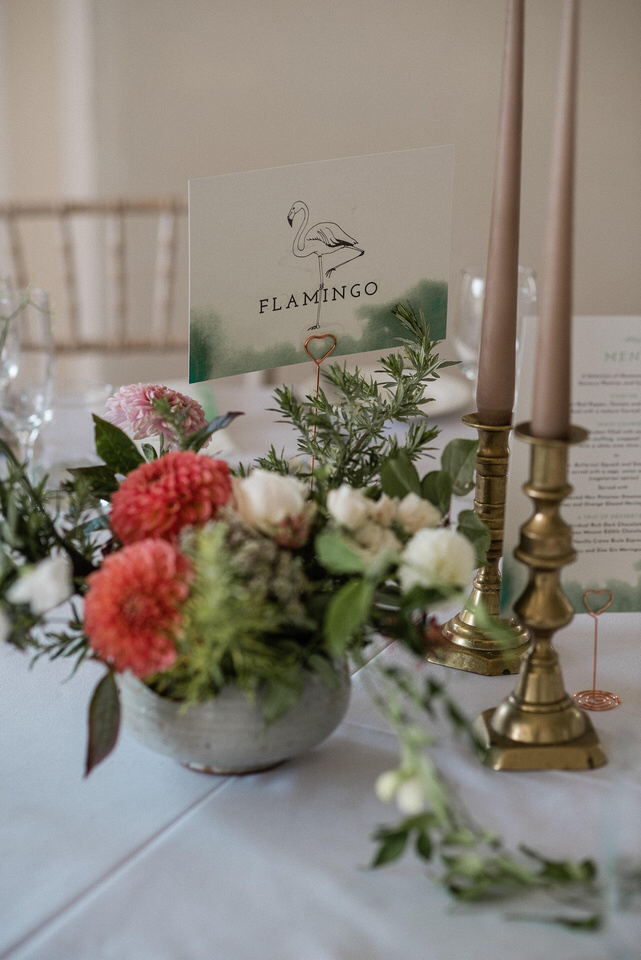 To coordinate with their invitations we created table names, menus and a table plan all featuring the signature green watercolour paint pattern.