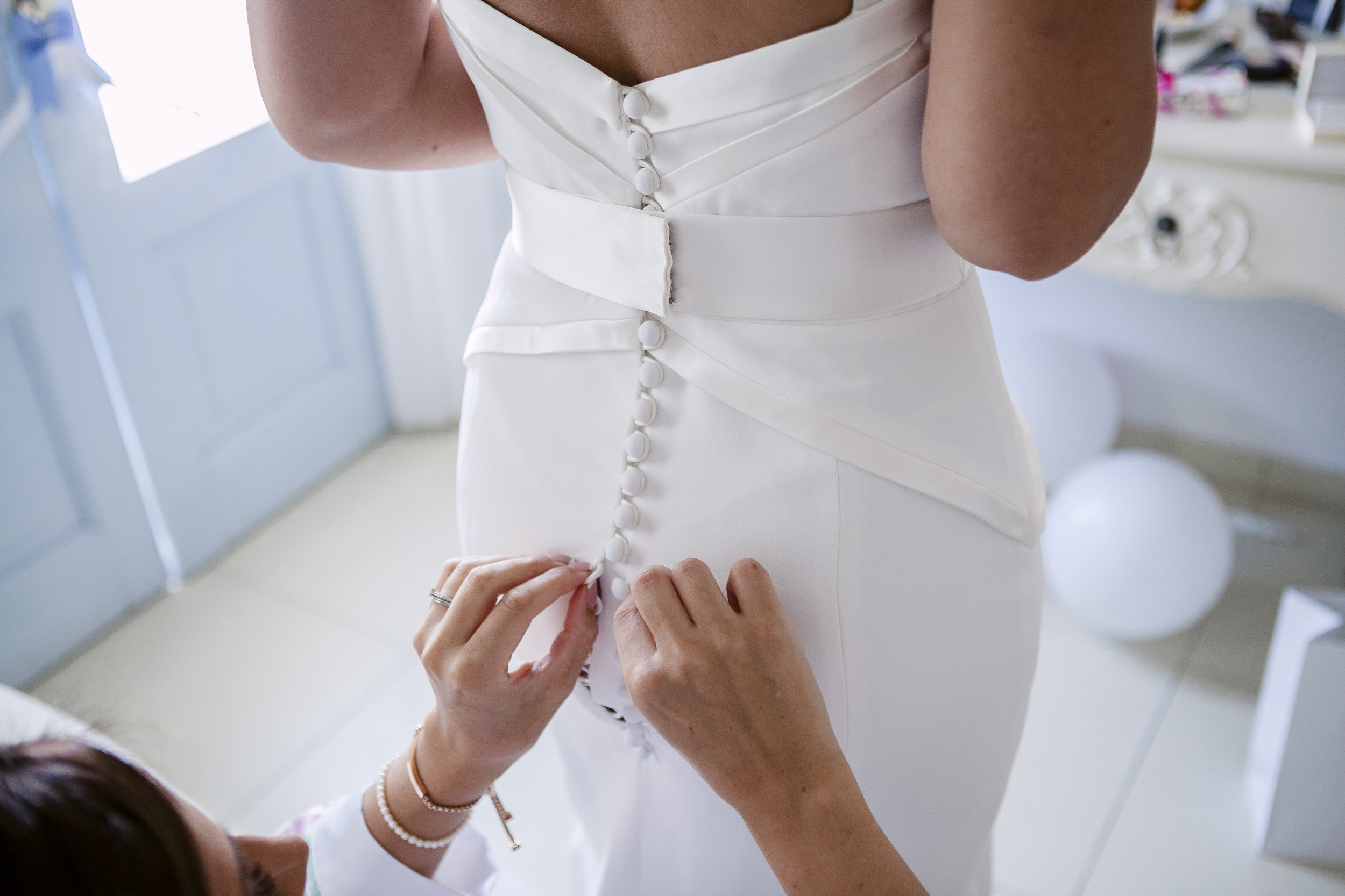 Wedding dress by  Suzanne Neville