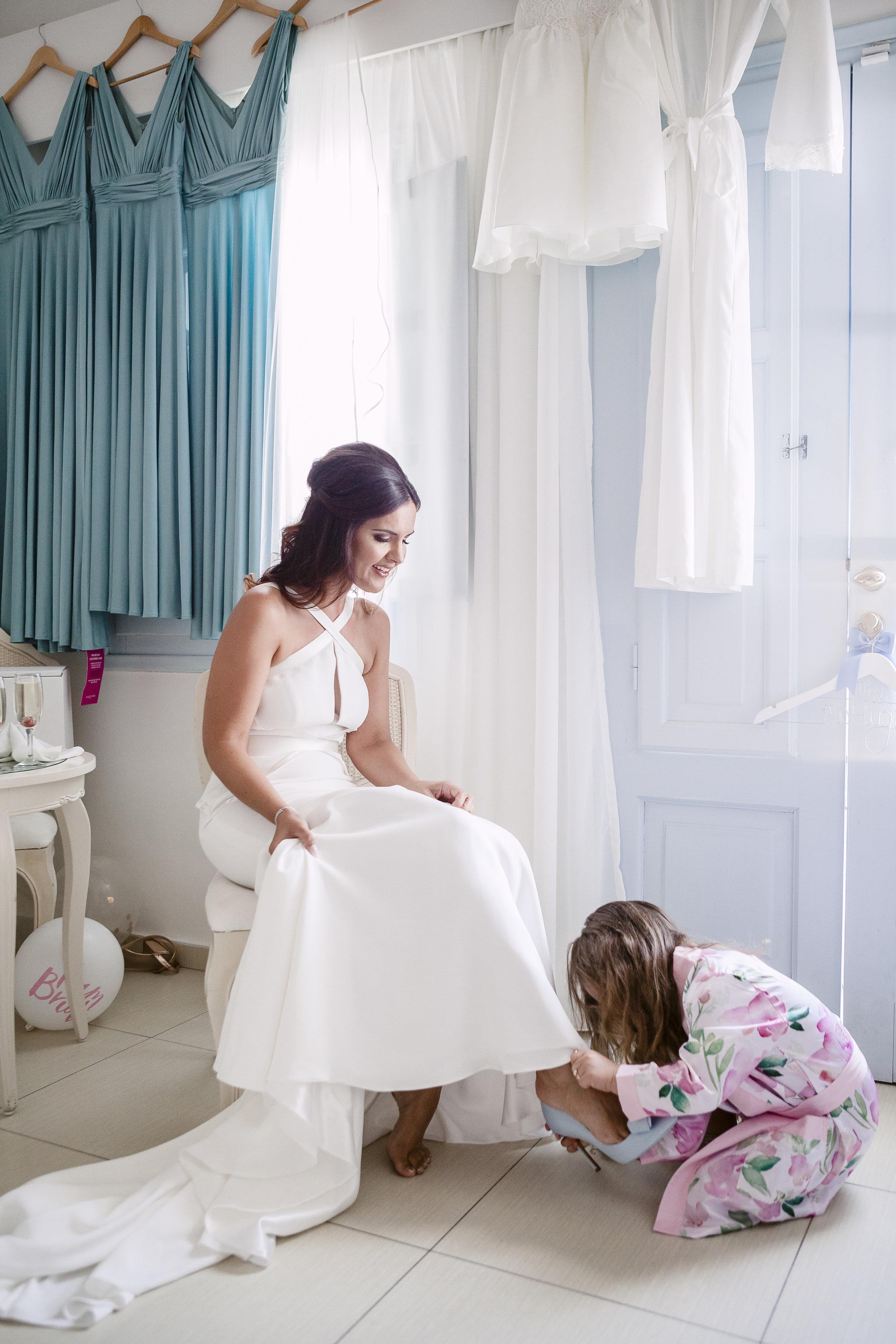 daughter putting on shoe.jpg