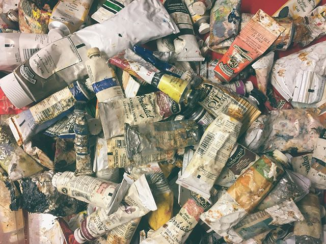 Doing squeeze tests on tubes today. Thinking about physical paint again. I've never bought paint outside of my normal 5 staples: red, yellow, blue, white, burnt umber. Yet I filtered down my paints from about 200 to 100 tubes today. People just give you paint when they know you paint. I am not not thankful. And I've been uncovering wildly specific colors for years now in this drawer. I use 'em and shrug a little. I don't know that I've ever seen a painting that called for something so specific that couldn't be mixed closely from my loyal 5. Short story long, don't give me oil paint. I have enough.  #artist #squeeze #oilpaint #painting #artishard #tobeminimal