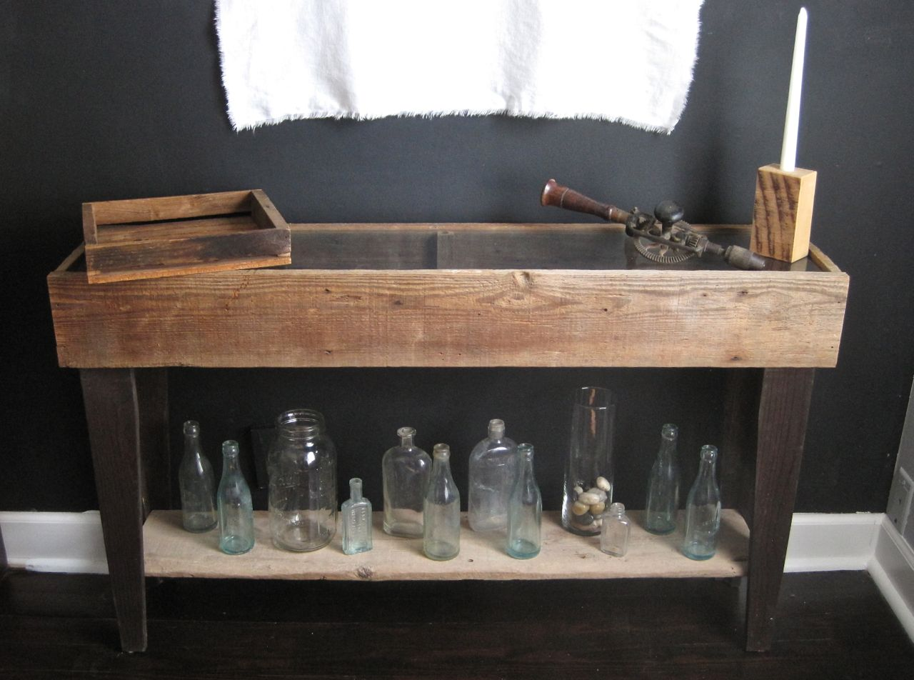 Console table with glass topped display