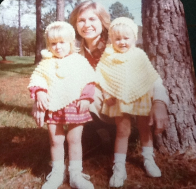 My twin sister, Natalie, my mom and me circa 1979. Fashionistas wearing ponchos and hats. We were two years old -Circa 1978.