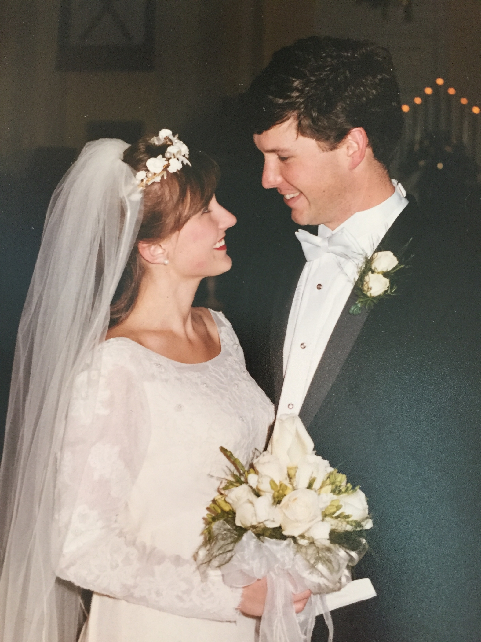 John and my wedding day wearing my mom's wedding dress. December 4, 1999