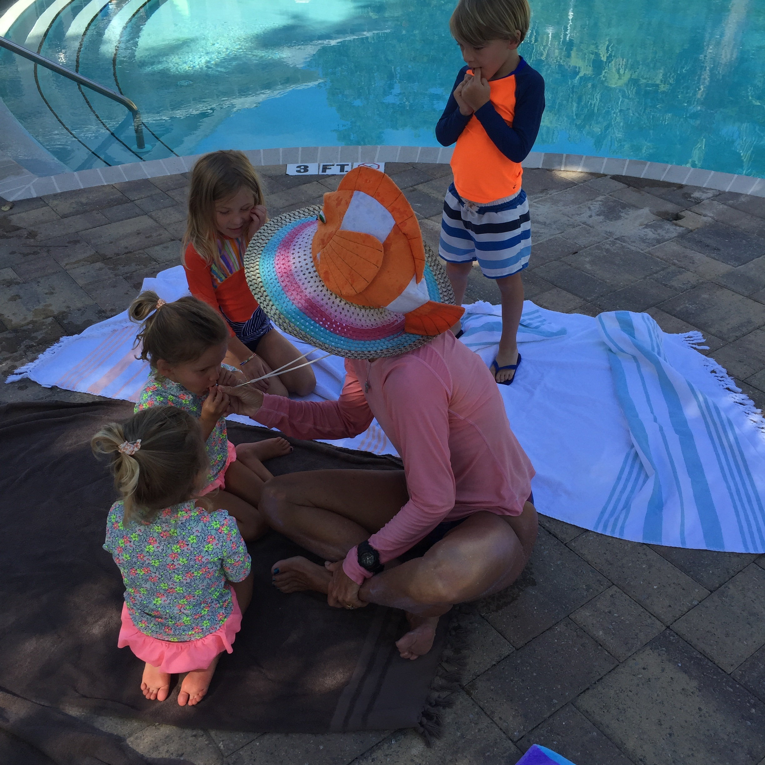 Going over pool rules before entering the water. This is a ritual that the kids love.