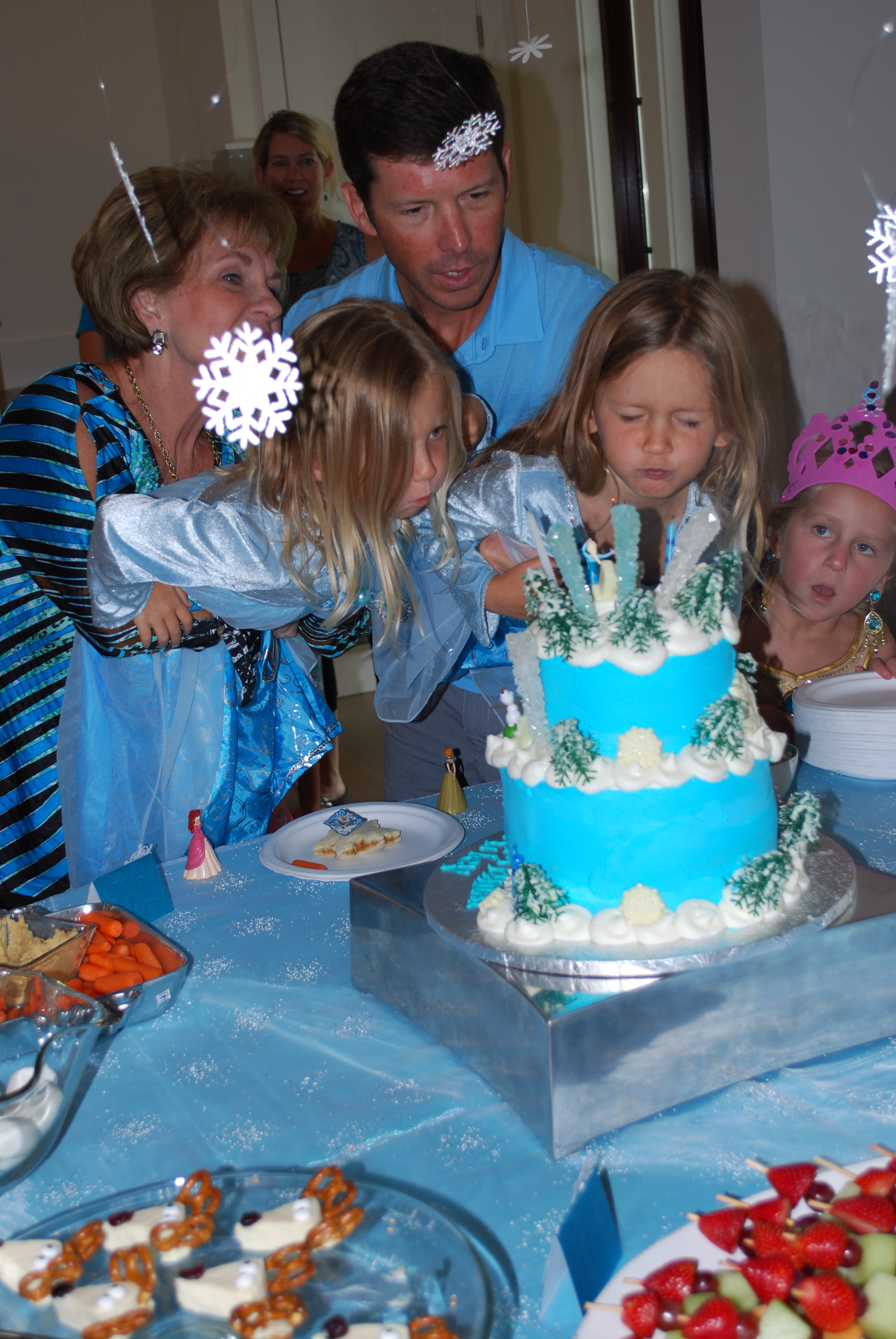 Blowing out the candles. Look at Cooper's face!! She's wishing hard --- LOVE!