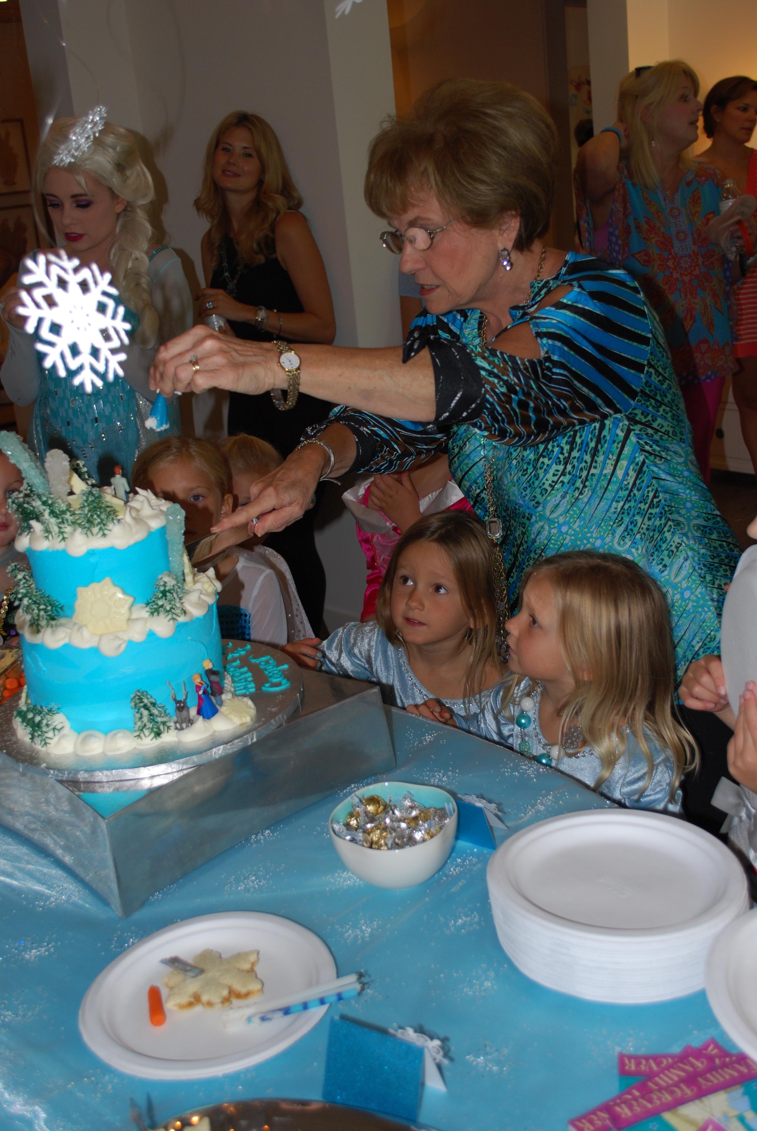 Nana cutting the cake
