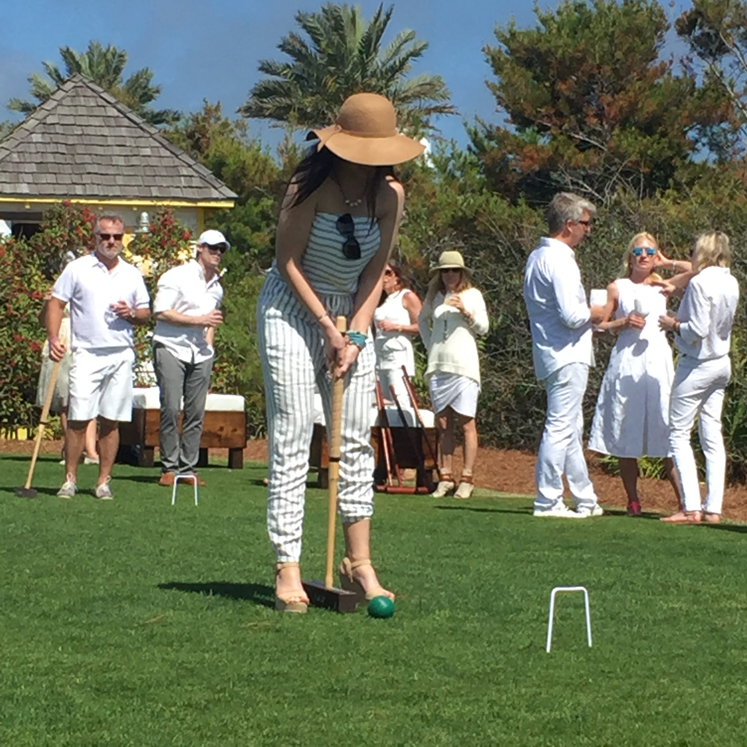 Very stylish, Hannah Billingsley playing in the croquet tournament.