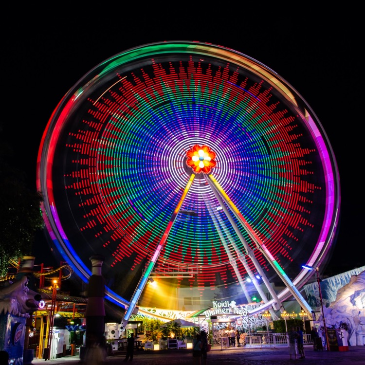 A long exposure of a Ferris wheel shot with a DSLR. We'll apply the same technique to iPhone photography