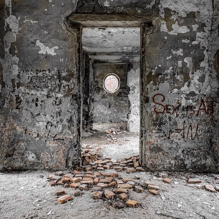 Bricks & door at the abandoned hunting lodge