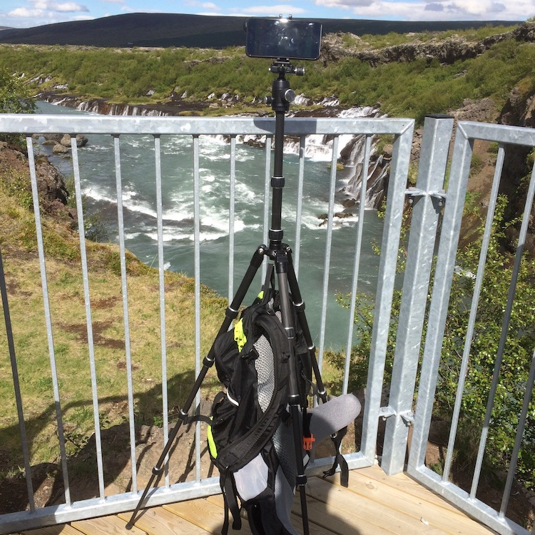 AmazonBasics Travel Tripod with iPhone mounted using Joby Griptight with my old backpack used as a stabilizing weight.