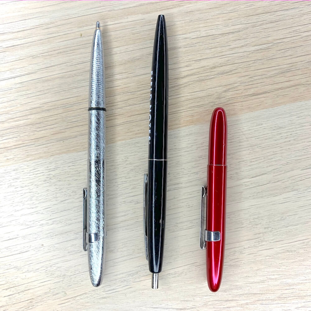 Bullet Space Pen size comparison (from l.t.r.): With cap on the back, normal click pen, with cap closed.