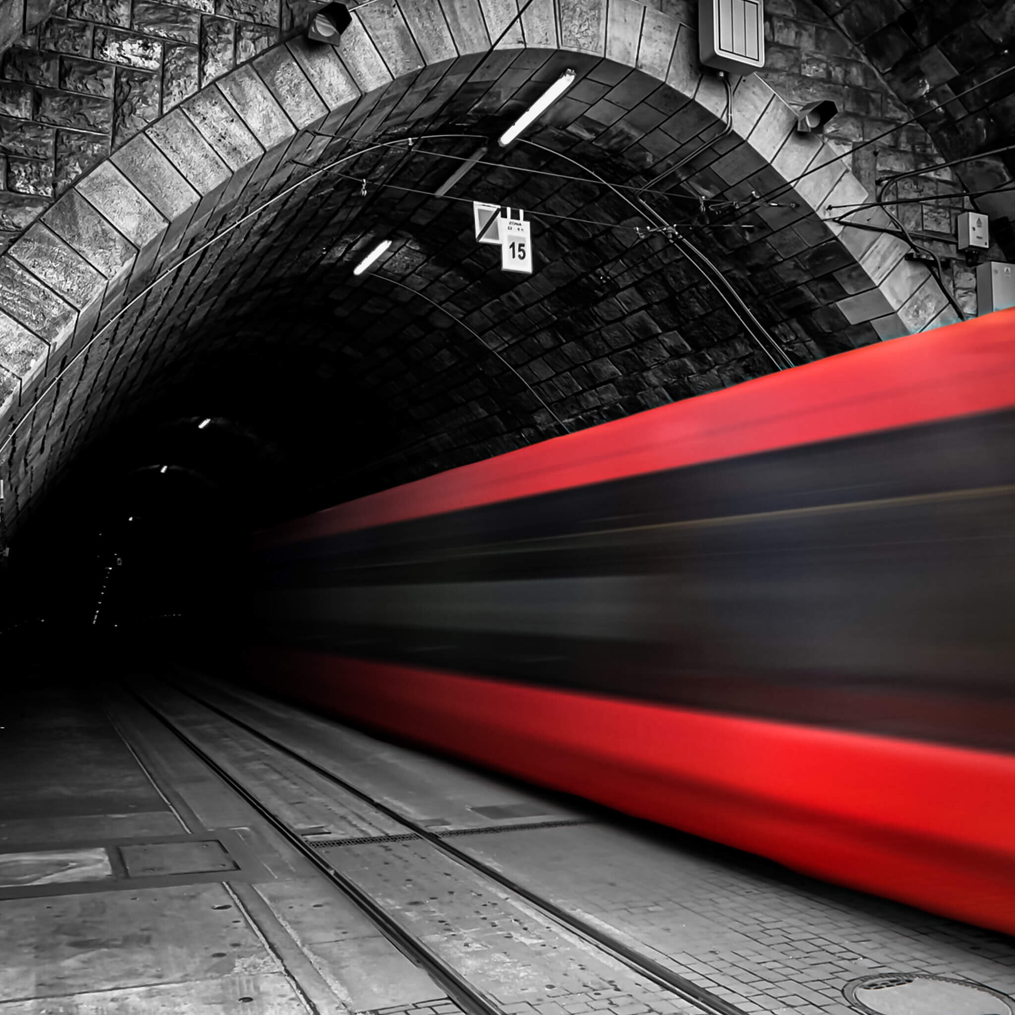 Long Exposure of a tram entering the tunnel