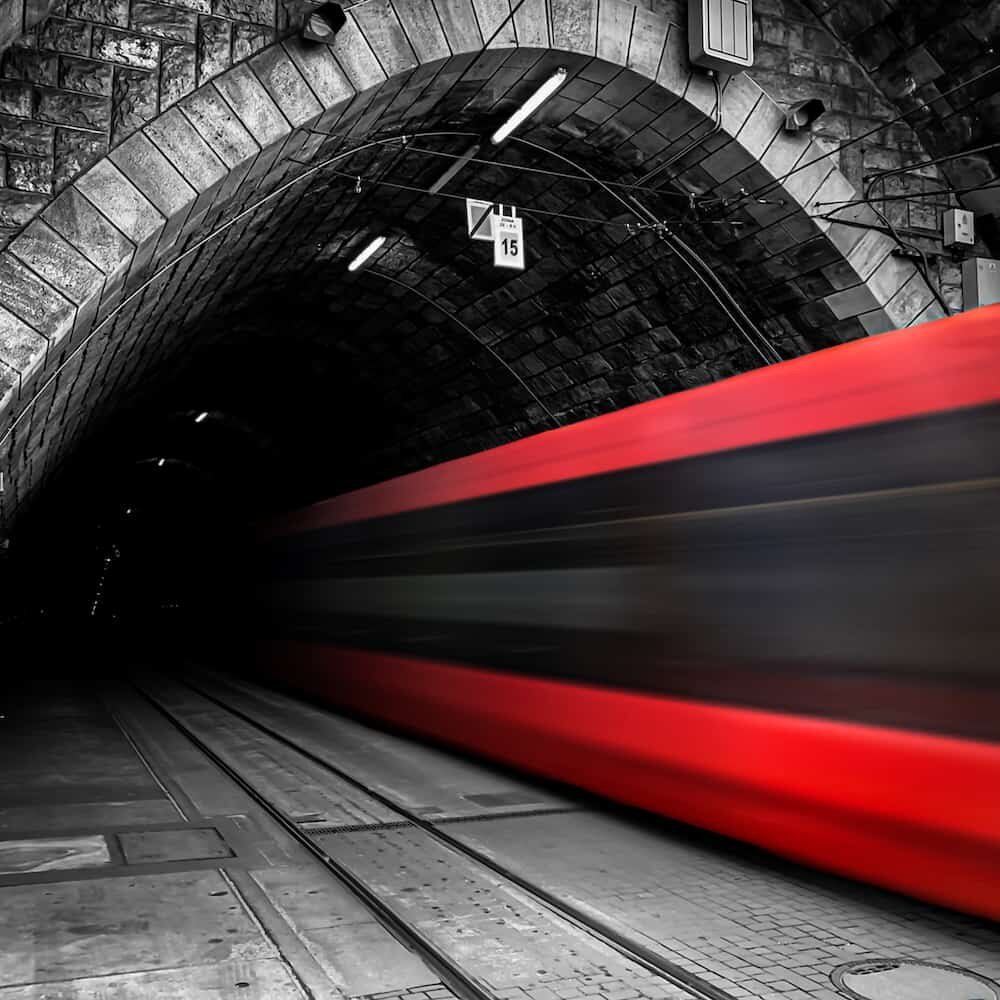 Live Photo Long Exposure of a streetcar entering a tunnel