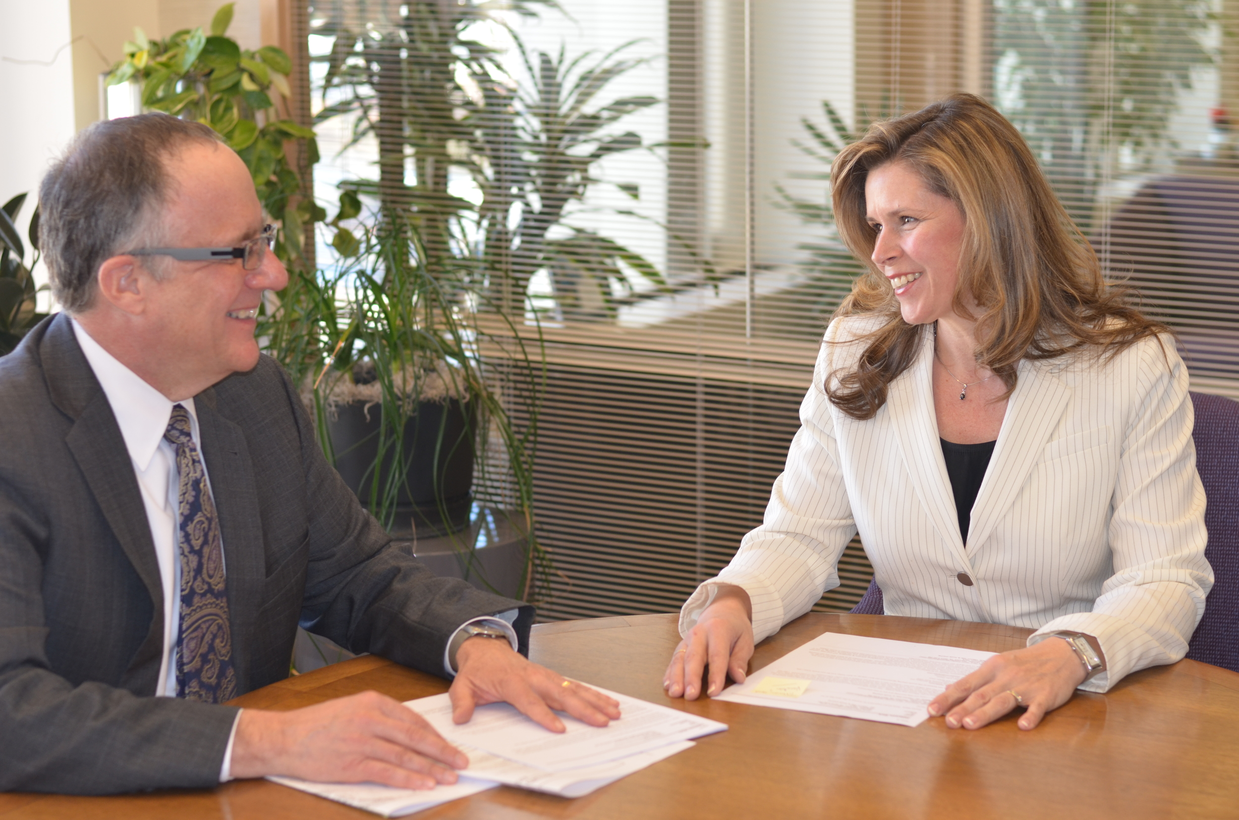 Marlo DeLange and Mark Patterson both represent clients in business matters.