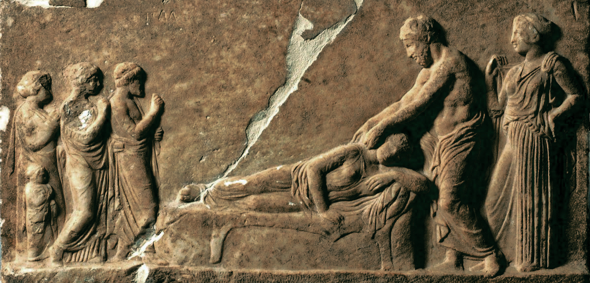 ANCIENT GREEK CARVING DEPICTING THE lying down PRACTICE OF INCUBATION