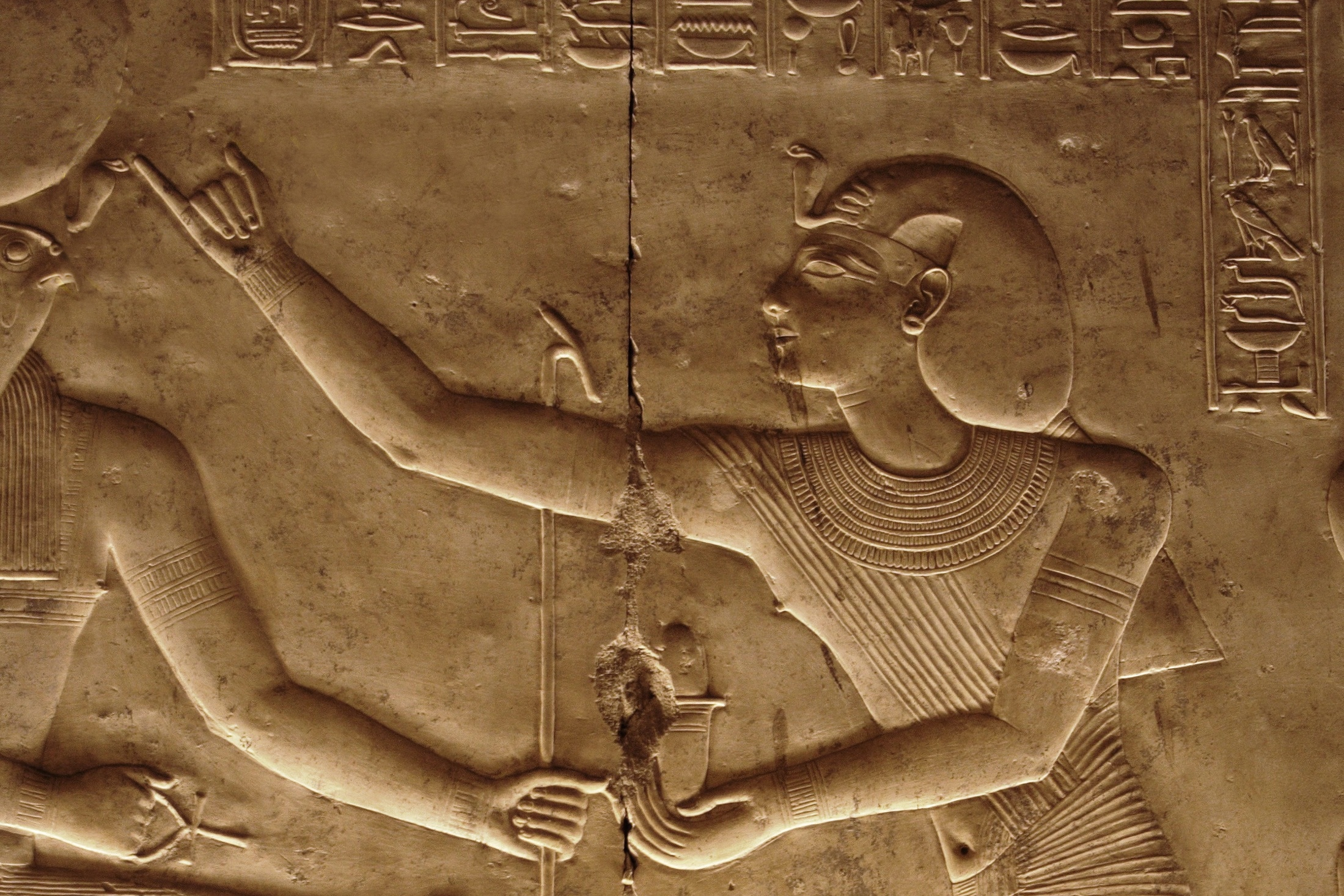Pharoah annointing a diety, Temple of Seti I