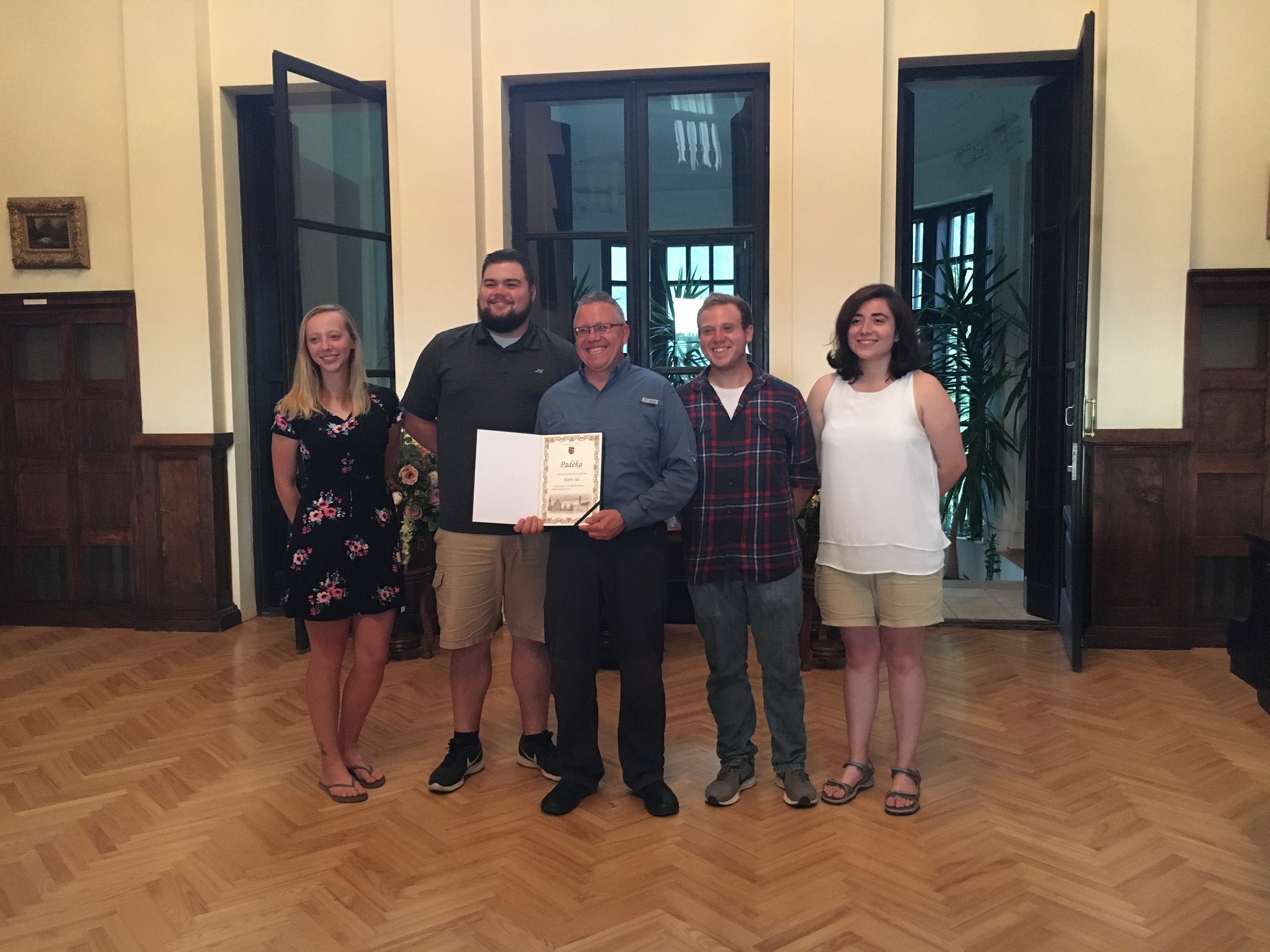 Jol, accompanied by students, receives international award for work in Rokiskis, Lithuania. Summer 2018