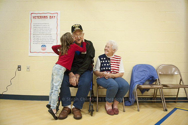 Molly Ray, 6, kisses her grandfather former Army Sgt. Merle Ray before she went back to class as Beverly Ray looks on after a Veterans Concert at Derry Area's Grandview Elementary School on Friday, Nov. 6, 2015.