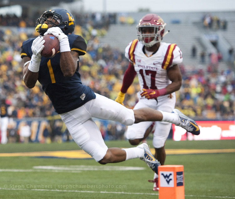 West Virginia wide receiver Shelton Gibson (1) attempts to make a diving catch in front of Iowa State defensive back Jomal Wiltz (17) on Saturday, Nov. 28, 2015, at Milan Puskar Stadium in Morgantown, W.Va. Gibson couldn't complete the pass in the end zone. WVU won 30-6.