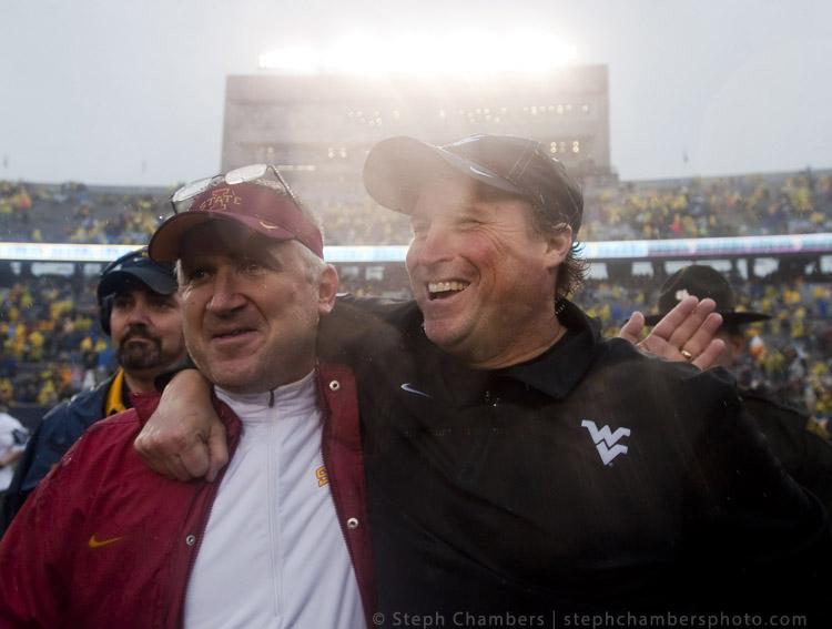 West Virginia head coach Dana Holgerson greets Iowa State Offensive Coordinator Todd Sturdy on Saturday, Nov. 28, 2015, at Milan Puskar Stadium in Morgantown, W.Va. WVU won 30-6.