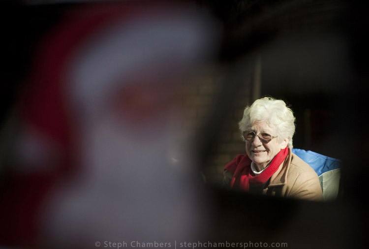 A woman is seen through a window of a Santa-themed float during the 24th annual holiday parade on Saturday, Nov. 21, 2015, in Greensburg.
