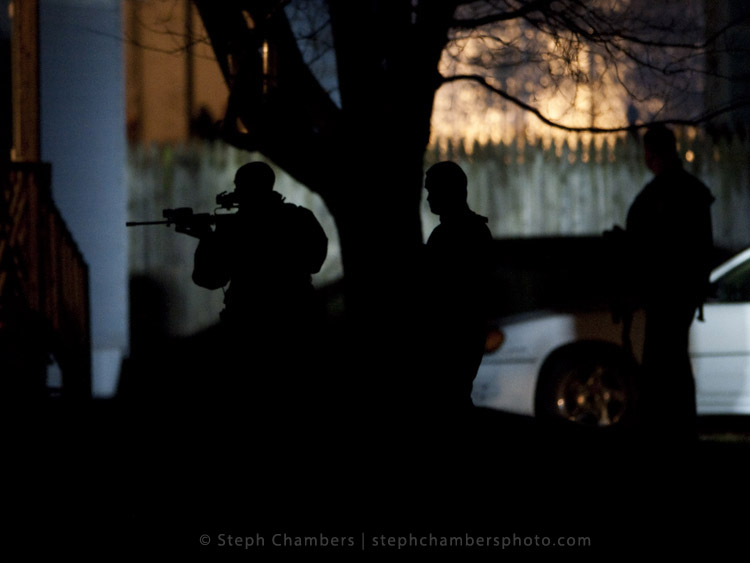 Police search for a suspect in connection with an officer shooting on Saturday, Nov. 28, 2015 in Seward.