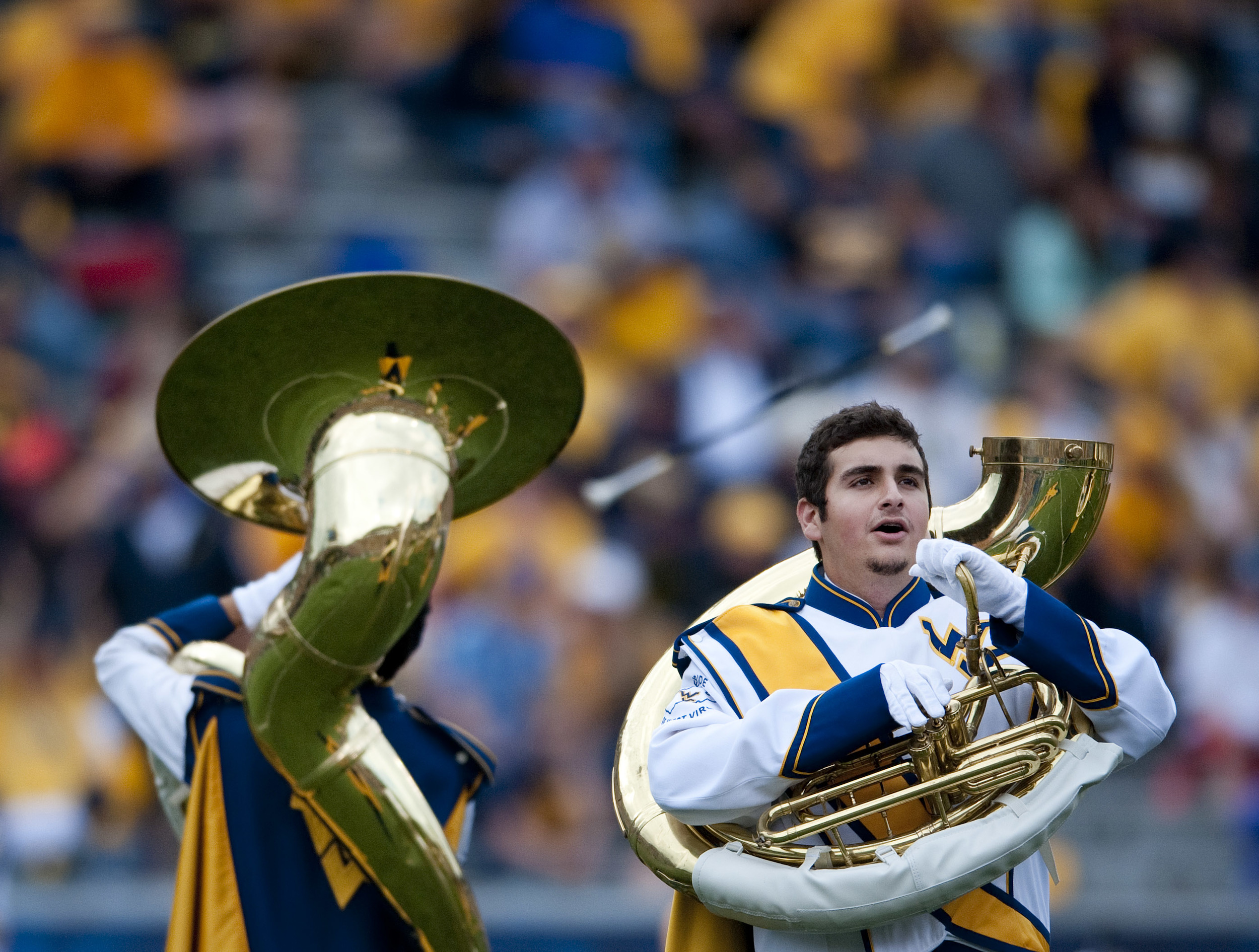 A West Virginia tuba player sings a march after losing his horn top on Saturday, Sept. 12, 2015 at Milan Puskar Stadium in Morgantown, W.Va. WVU won 41-17 over Liberty.